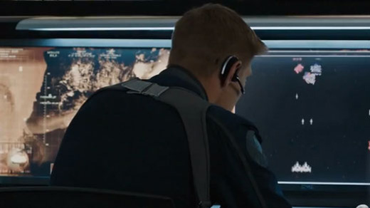 What video game is one of the crew playing while Tony is on the bridge of the Helicarrier in The Avengers?